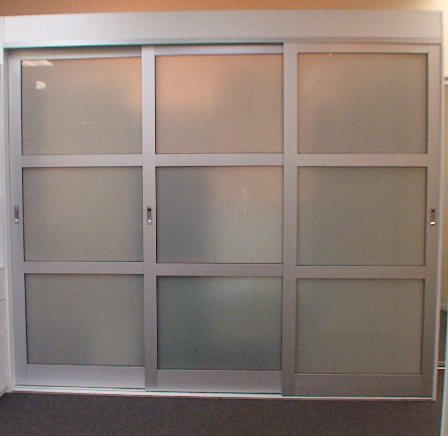 Furniture White Glass Sliding Doors With Black Wooden Frame On