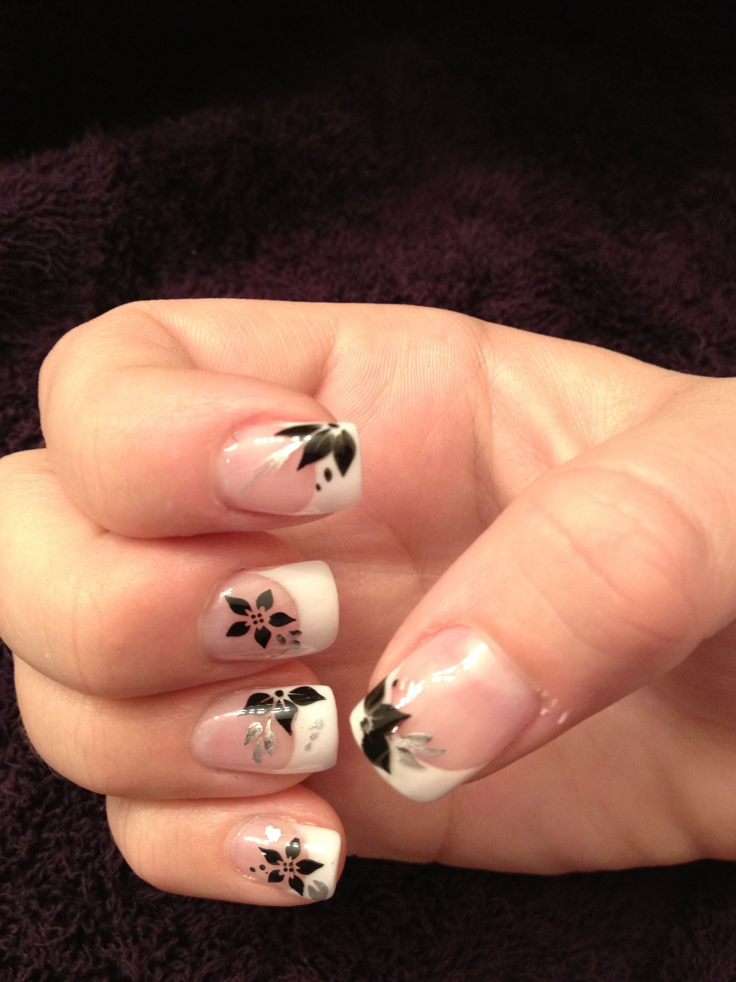 My nails white gel tips with black flowers and silver leaves each
