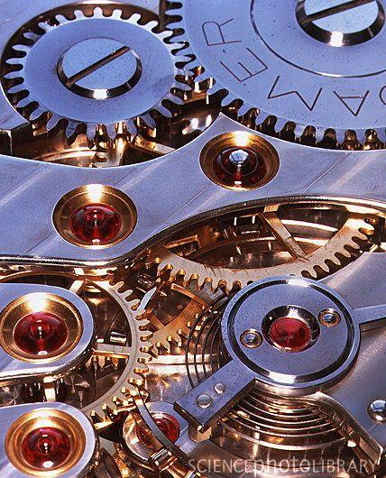 Internal cogs and gears of a 17-jewel Swiss watch | Keeping a