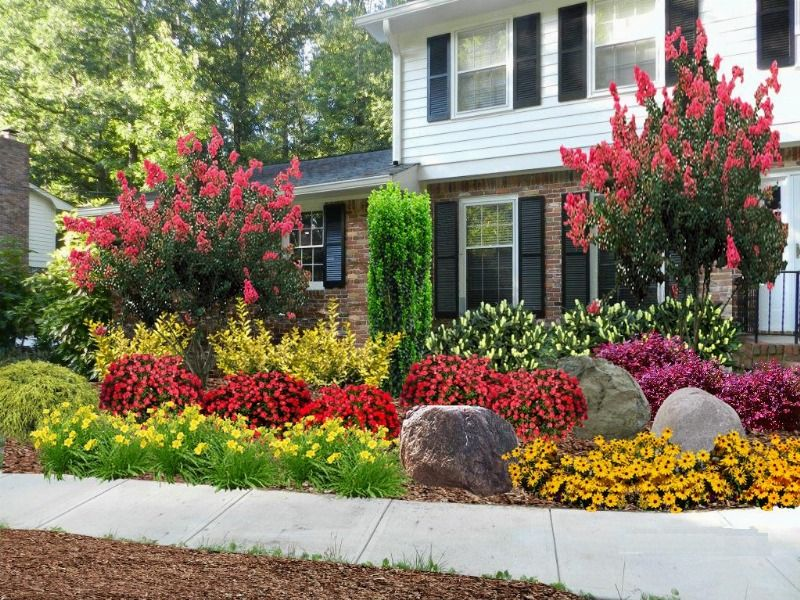 38 Homes That Turned Their Front Lawns Into Beautiful: This Colorful Landscape Design Includes Crape Myrtle, Sky