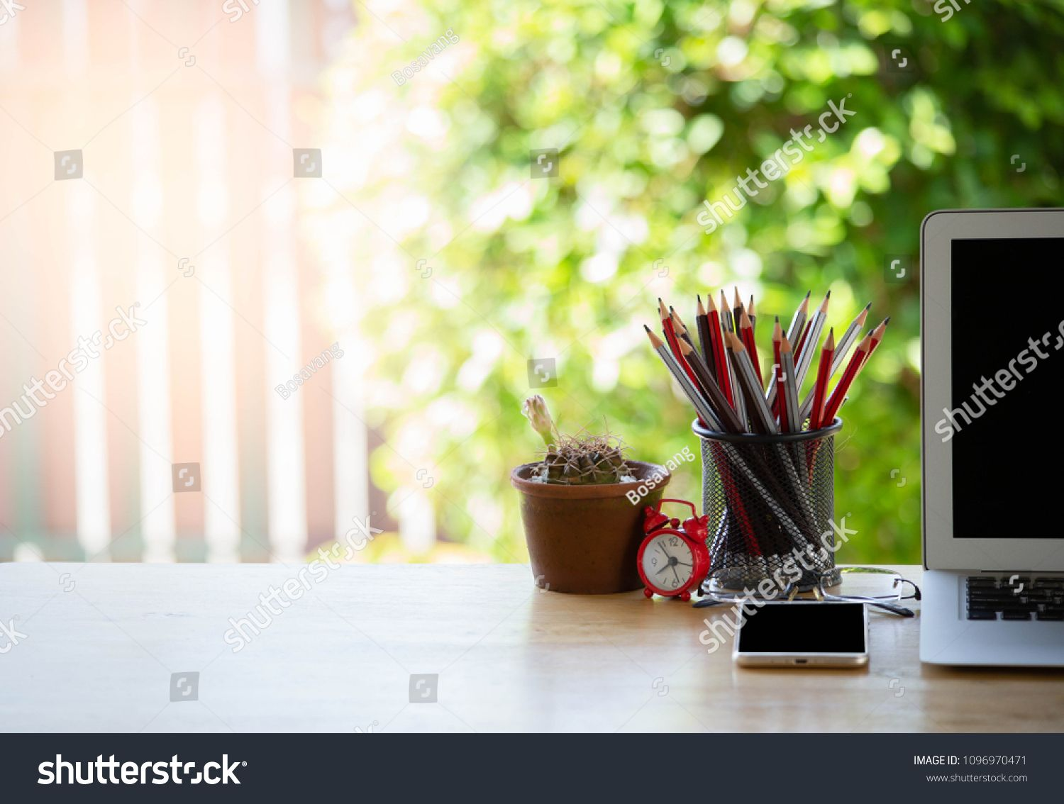 Desk work at home,Laptop with phone and stationary on wooden table blurred garden background,selective focus. #Ad , #Sponsored, #Laptop#phone#stationary#Desk