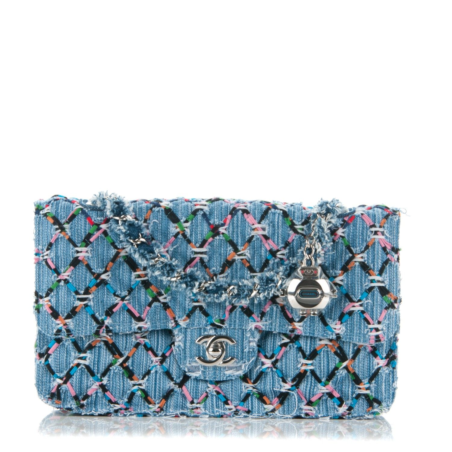 75c228c964f8 This is an authentic CHANEL Woven Denim Quilted Medium Flap in Blue and  Multicolor. This