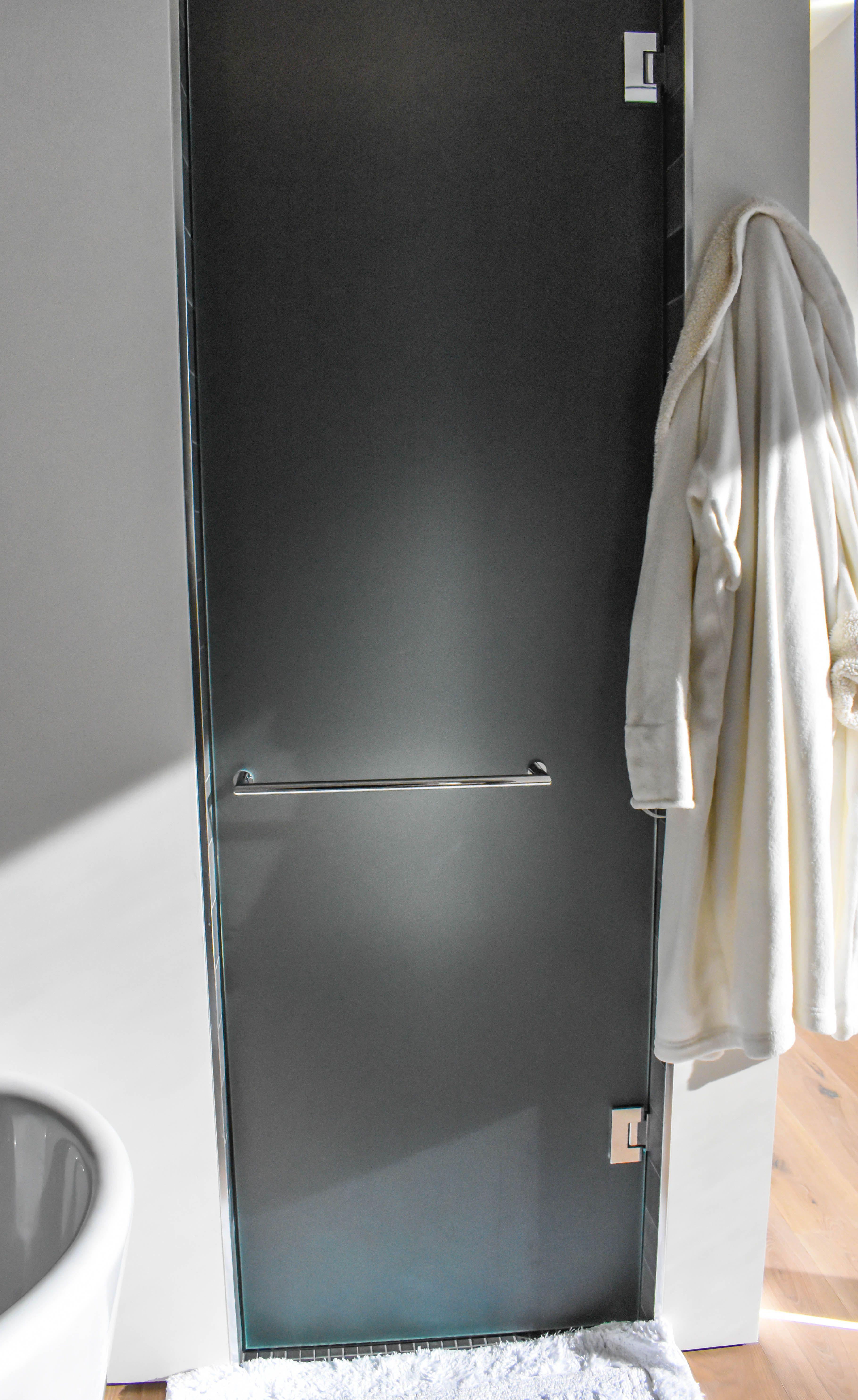 Custom Shower Door Created With Starfire Glass Chrome Hardware