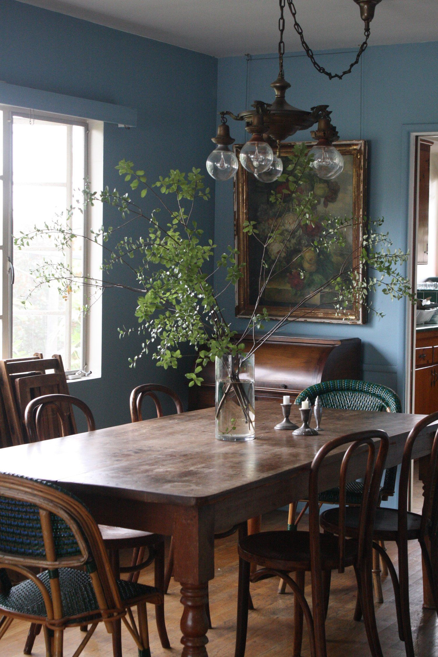 light blue dining chairs. Light Blue Dining Room Gold Accent Farm Table Reclaimed Bentwood Chairs Oversized Flowers Vase Flower Chandelier