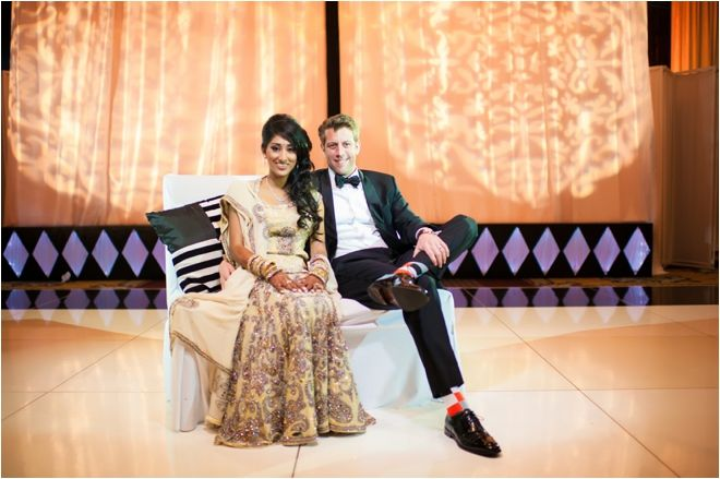 Indian Bride Wearing Beige Lengha And Groom Wearing A Black Suit And Bow Tie Photo Biyani
