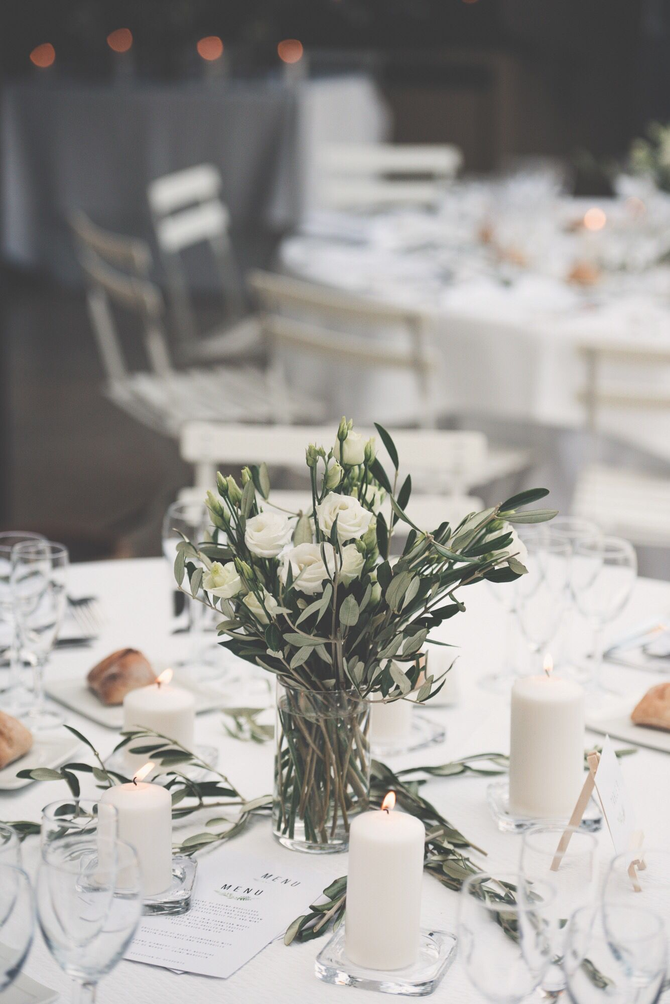 Wedding dinner in Provence. White flowers, olive branches and candles #whitecandleswedding