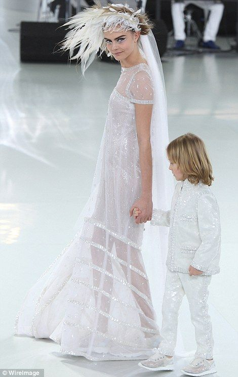Glitz and glamour: Cara's dress was adorned with dazzling crystals and she accessorised with a father head dress