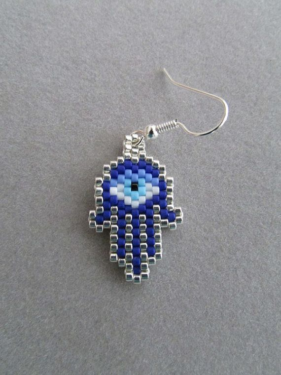 These beaded Hamsa earrings contain approximately 254 tiny delica beads, intricately woven together, one bead at a time, with a beading needle and beading thread to create the finished item you see here. They measure 3/4 inches wide and 1-1/8 inches long, excluding the ear wires.  The pierced fish hook ear wires are silver plated.  They would make a great gift any time of year.  Handcrafted in a smoke free environment.  Thanks for stopping by. Please feel free to check out the rest of my…