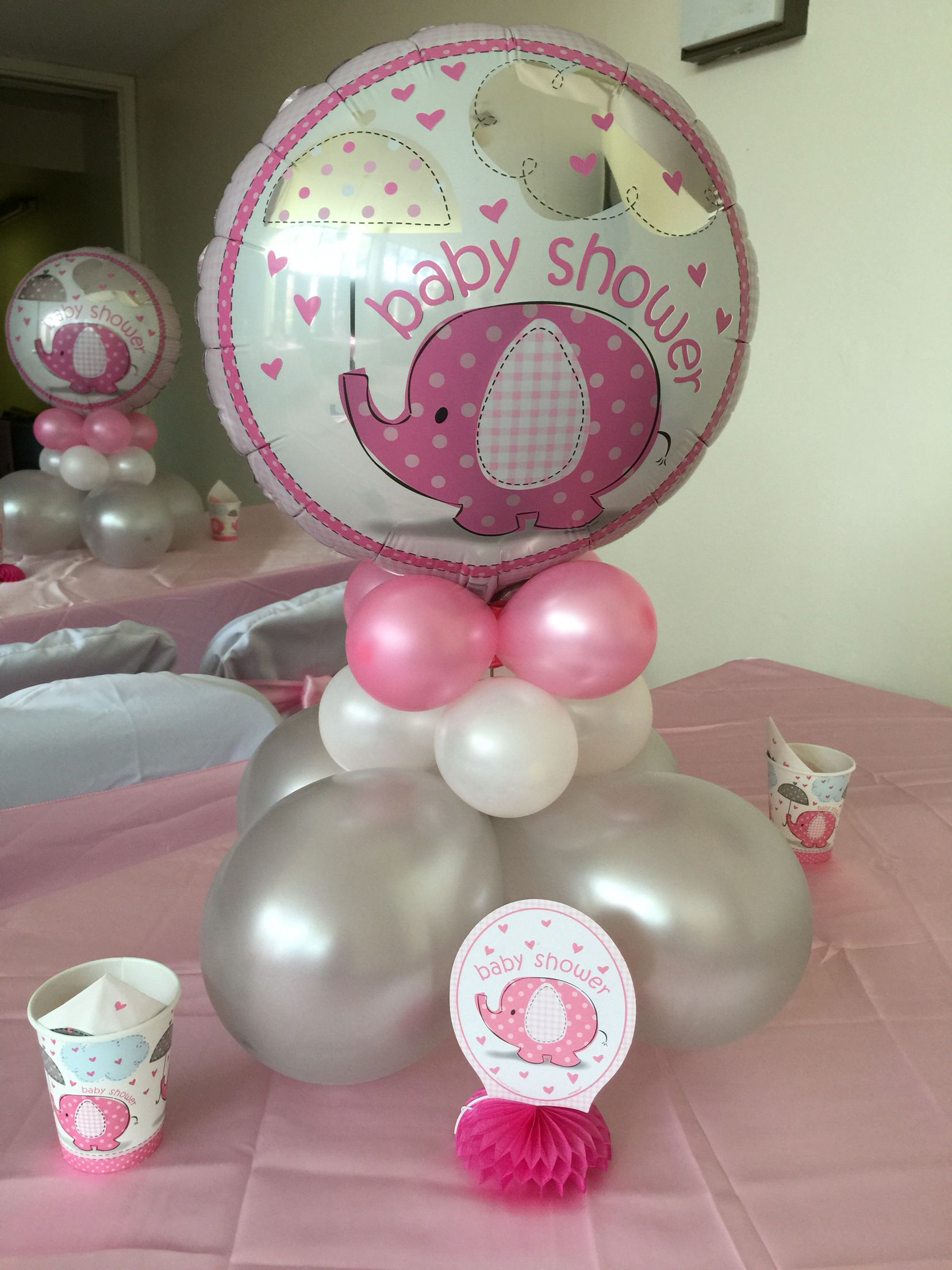 Baby elephant centerpiece with balloons pink shower