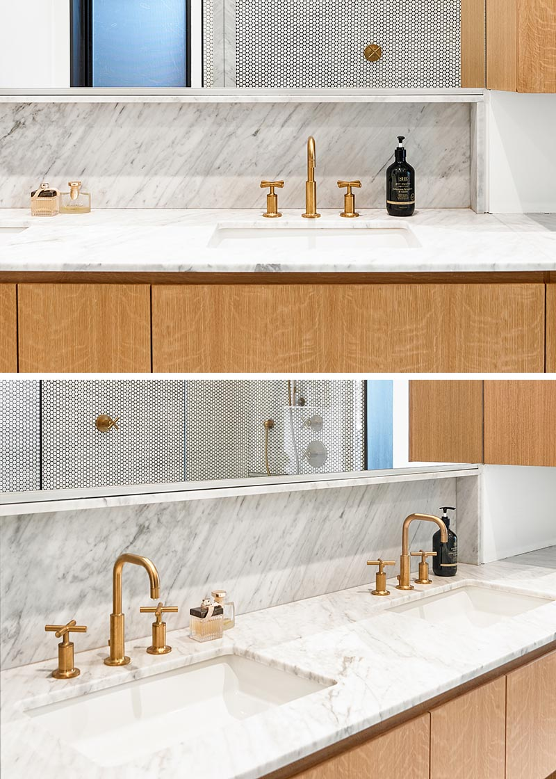 Photo of Penny tiles and brass fittings set the scene for this bathroom design