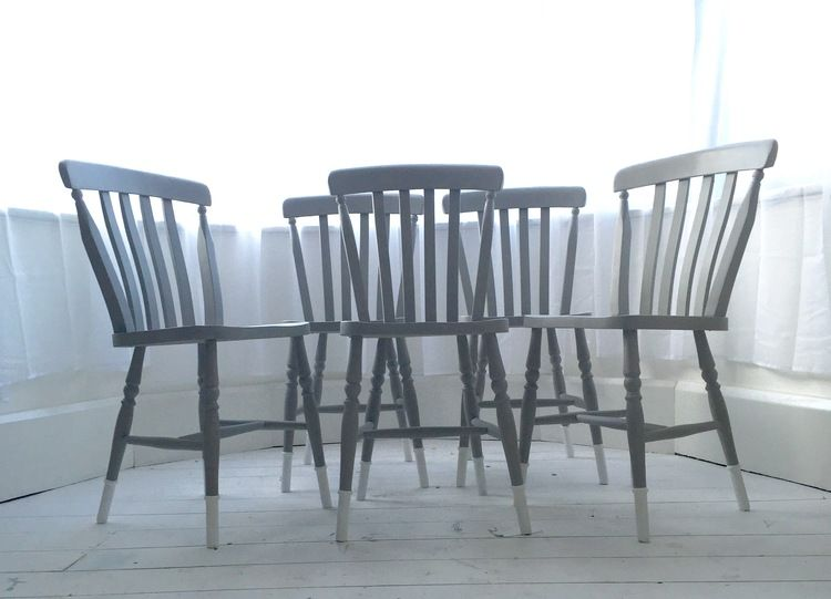 Farmhouse chairs given a modern twist for a client by using Annie Sloan's Paris Grey and Pure for the dipped legs
