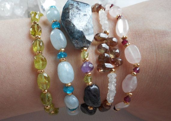 Bracelet Stack! I love layering and stacking my gemstone bracelets, mixing contrasting colours and textures. Pictured here are bracelets with Peridot, Aquamarine, Blue Apatite, Gemmy Kyanite, Amethyst, Andalusite, Rainbow Moonstone, Garnet and Rose Quartz, all available in my Etsy shop.