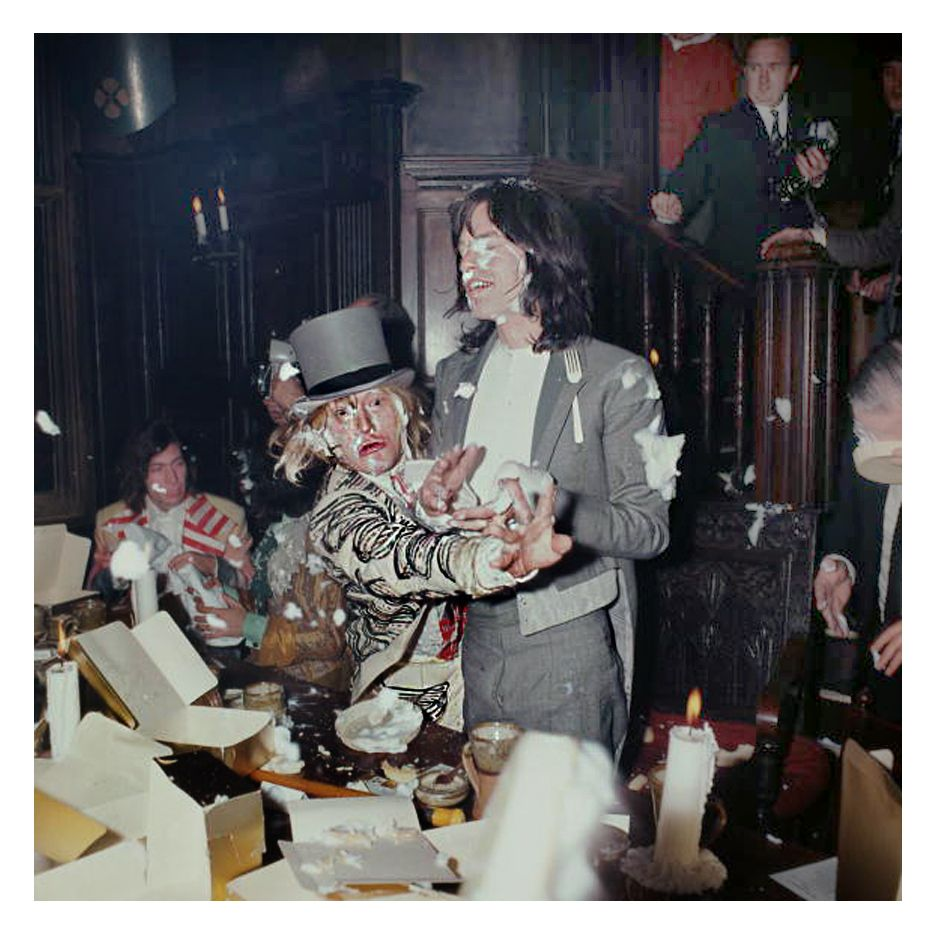 Brian Jones and Mick Jagger of the The Rolling Stones, enjoying a food fight at the Kensington Gore Hotel, where the band staged a mock-medieval banquet for the launch of their new album 'Beggars Banquet', (Douglas Miller)