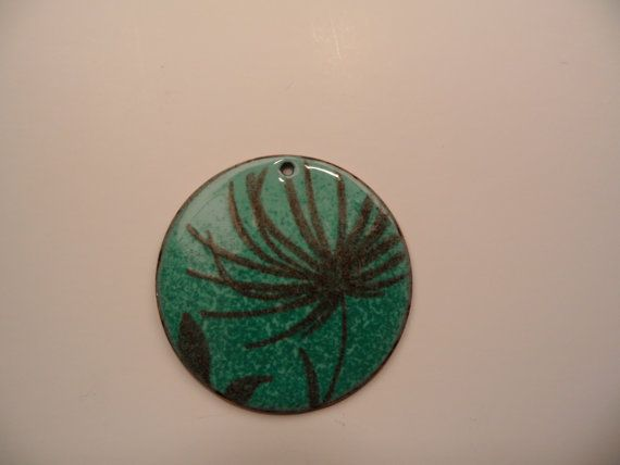 I truly love Hosanna Rubio's work.  I own one of her pieces, and and looking forward to the next.  This pendant looks like you could swim in it.  http://www.etsy.com/people/HosannaRubio?ref=ls_profile