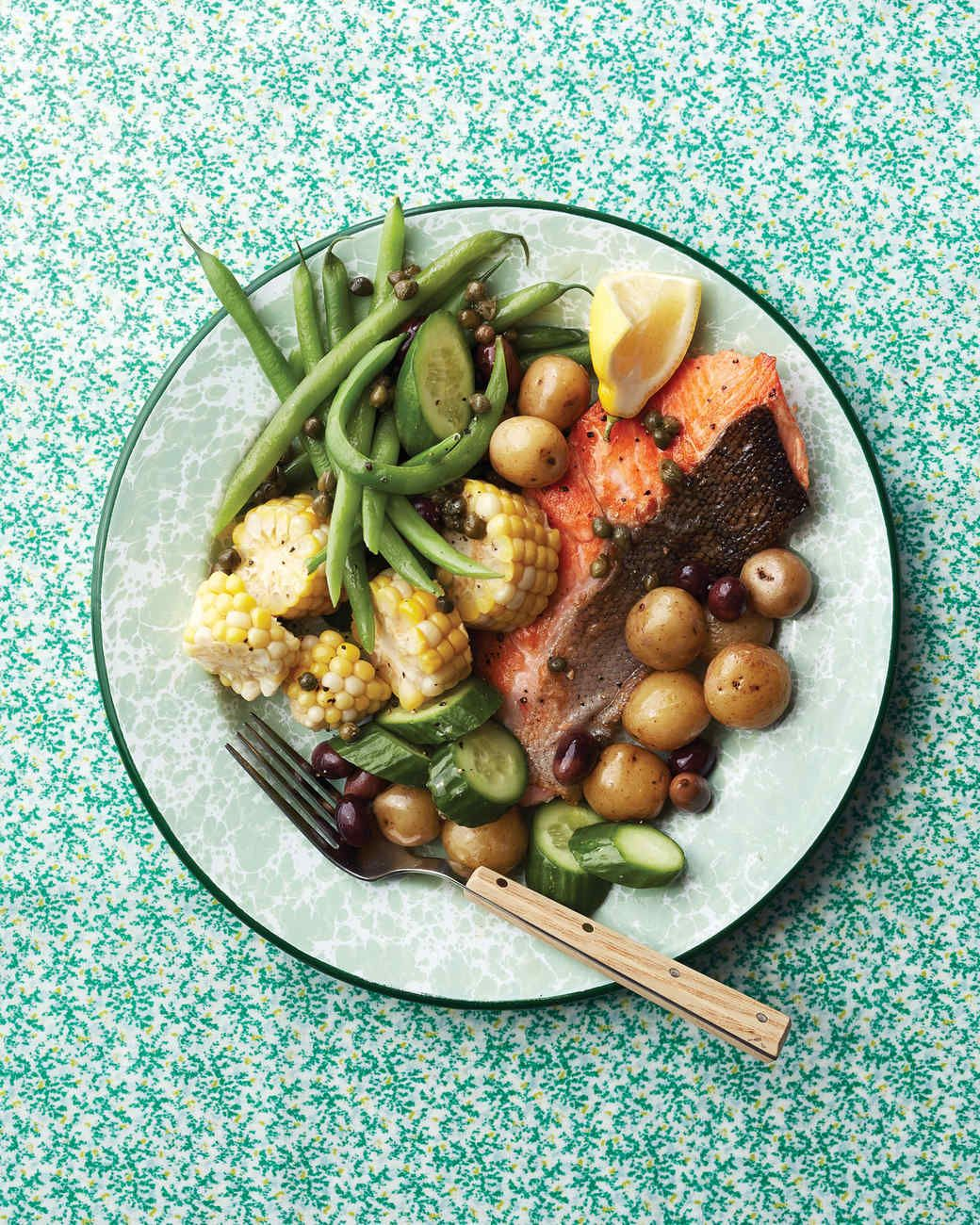 Lemony caper vinaigrette heightens the flavors of sweet summer corn and crisp, cool cucumber in this unconventional take on salade Nicoise.