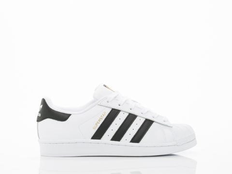 Low-top brushed leather sneakers in white. Tonal lace-up closure. Logo flag  in white at outer side. Textured rubber midsole in white featuring logo in  red ...