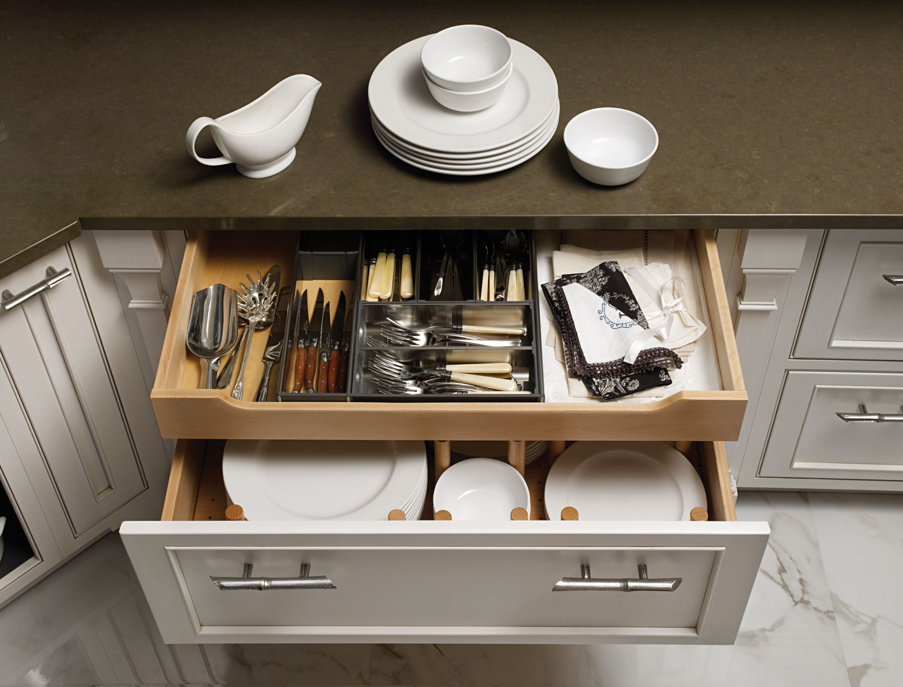 "Clever storage: Behind a deep drawer front, is tucked a 4"" pull ..."