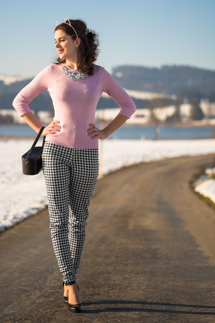 RetroCat with vintage hair, gingham trousers and pink sweater