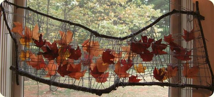 "Leaf weaving mobile in the window to catch the Autumn sun's rays at Ivy Forest School ("",)"