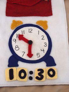 Bonito reloj de fieltro ideal para trabajar el funcionamiento del reloj con los niños.