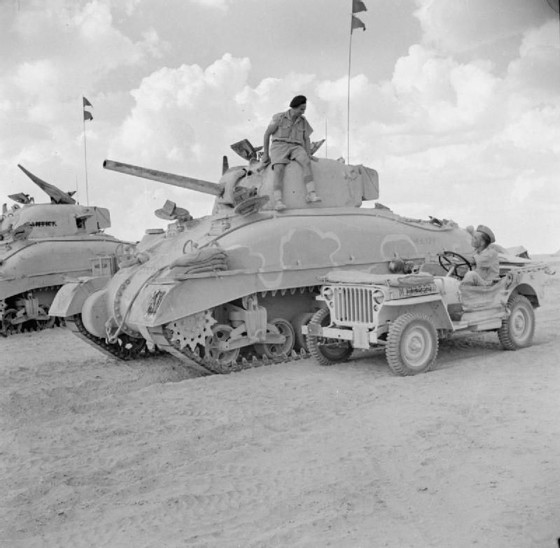 """A jeep and Sherman tanks of HQ 2nd Armoured Brigade, 10 October 1942. """"The white line on the tank was being used as a guideline by the Camouflage Unit who were called away before completing the painting of the Brigade's tanks."""" #worldwar2 #tanks"""