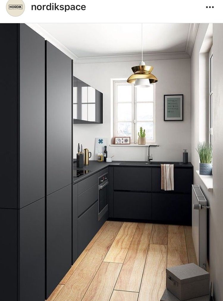 Love the look of these flat black kitchen cupboards the colour create a very clean and modern look and contrasts nicely with the white walls and wood