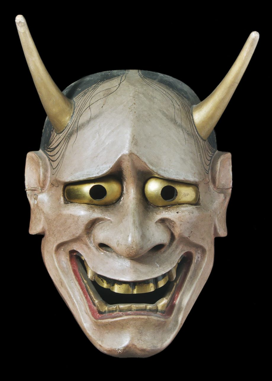 Wooden mask of a male face with moveable eyes. May never have been ...