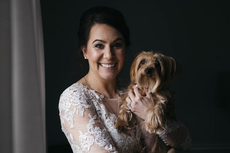 Bride with her dog on wedding day.