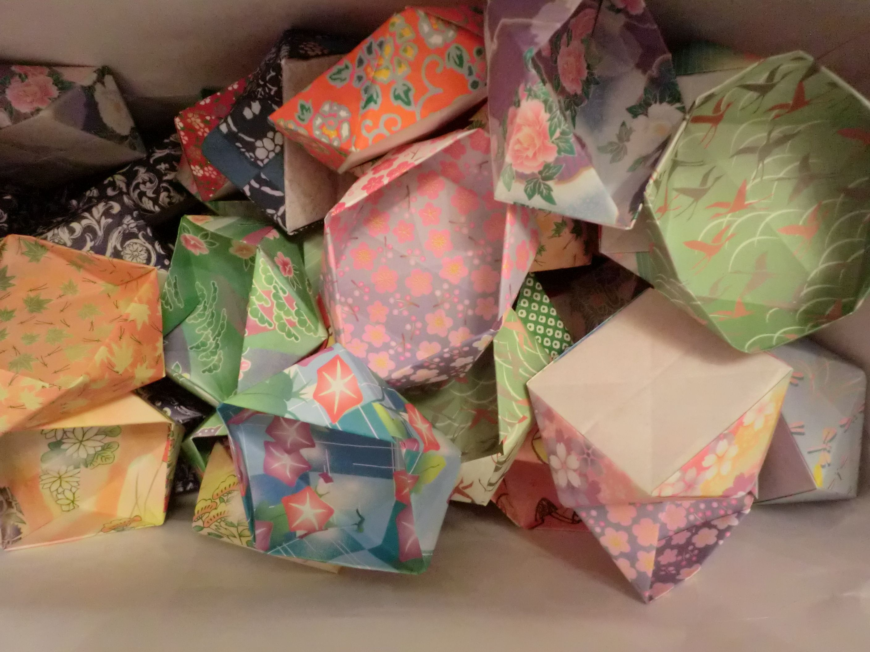 Tea Society prepares origami boxes for tea demonstrations.