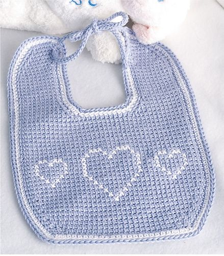 """This bib measures 7 3/4"""" x 10 3/4"""" and is worked in Tunisian Crochet. It is made in Light Periwinkle and White. The hearts are cross stitched on after the bib is complete."""