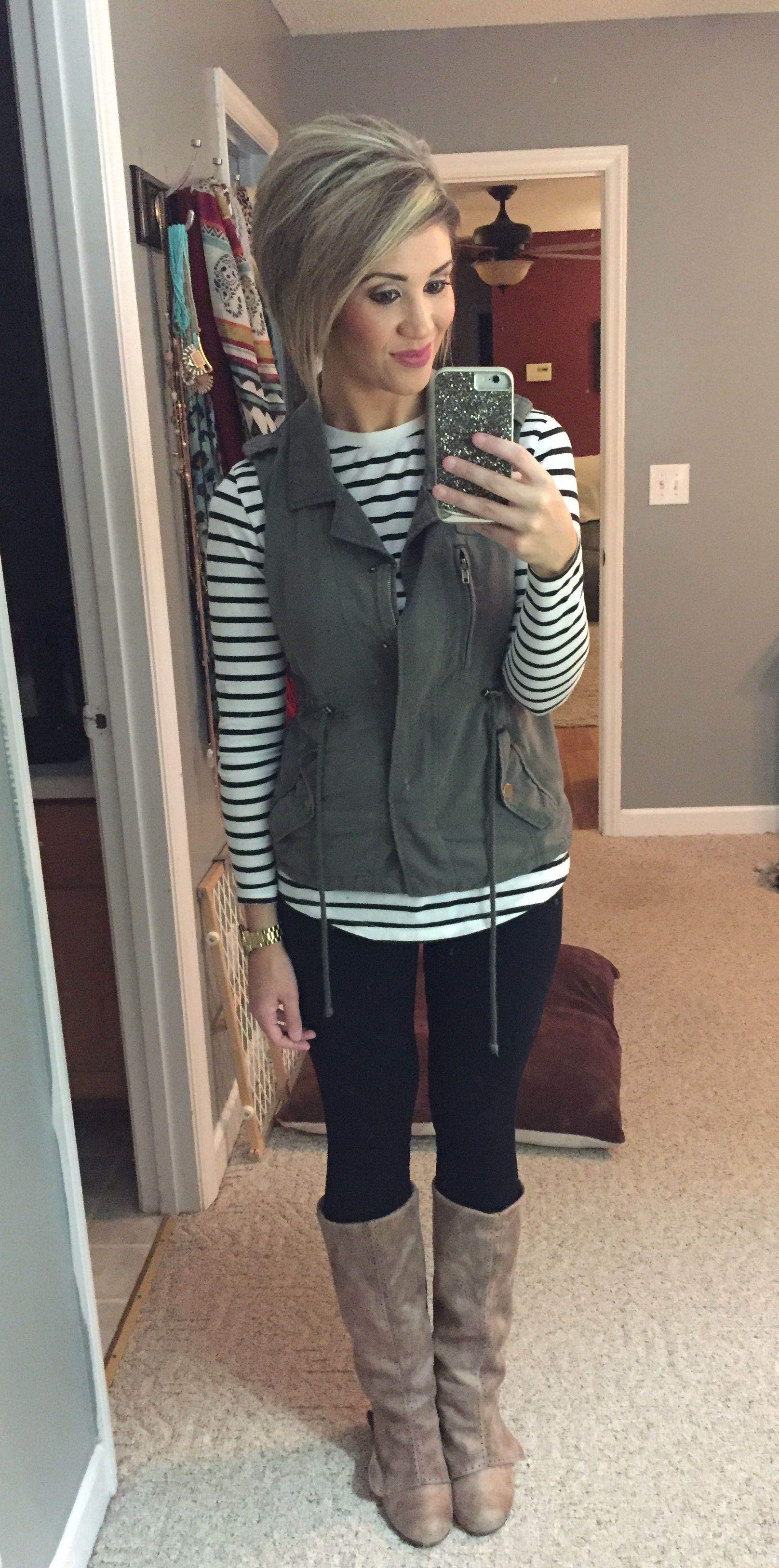 db698f901a5 Green military vest with striped shirt. Black leggings and boots fall outfit