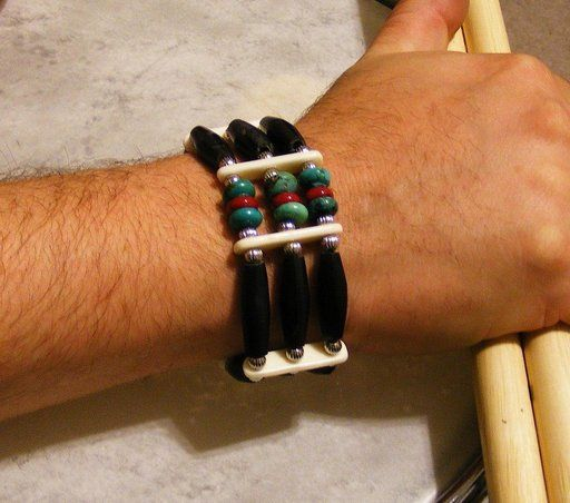 Black horn hair pipe bracelet with coral and turquoise.