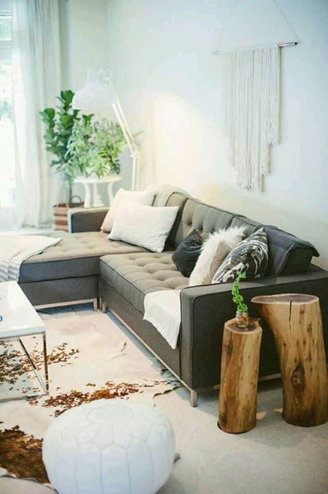 Beautiful Modern Living Room With Gray Couch, Cowhide Rug, And Tree Stump  Side Tables