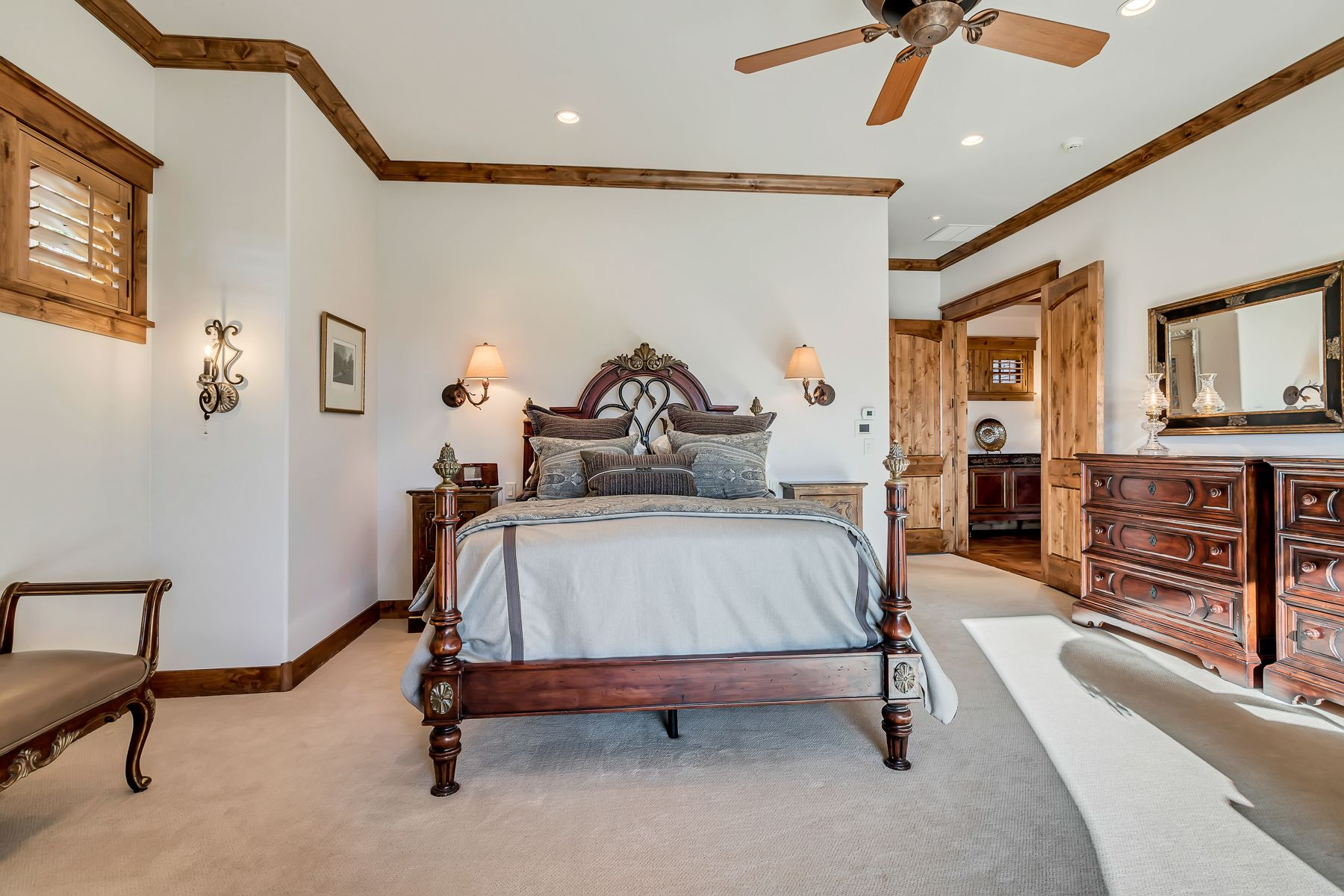 The main-level owner's suite, complete with fireplace and steam shower, boasts trophy views and a private setting creating a personal sanctuary for the owners of this one-of-a-kind Park City home. #WindermereUtah #Bedroom #OwnersSuite #OwnerBedroom #BedroomDesign #BedroomDecor #LuxuryHome #DreamHome #LuxuryLiving #LuxuryLifestyle #ParkCityHomes #UtahHomes #ParkCity #BedroomInspiration