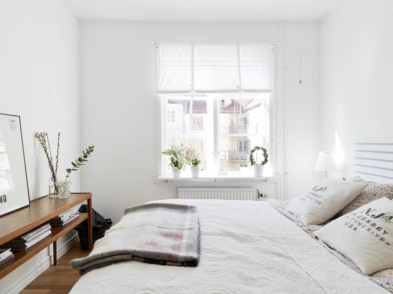 Small White Bedroom With Big Cozy Bed And