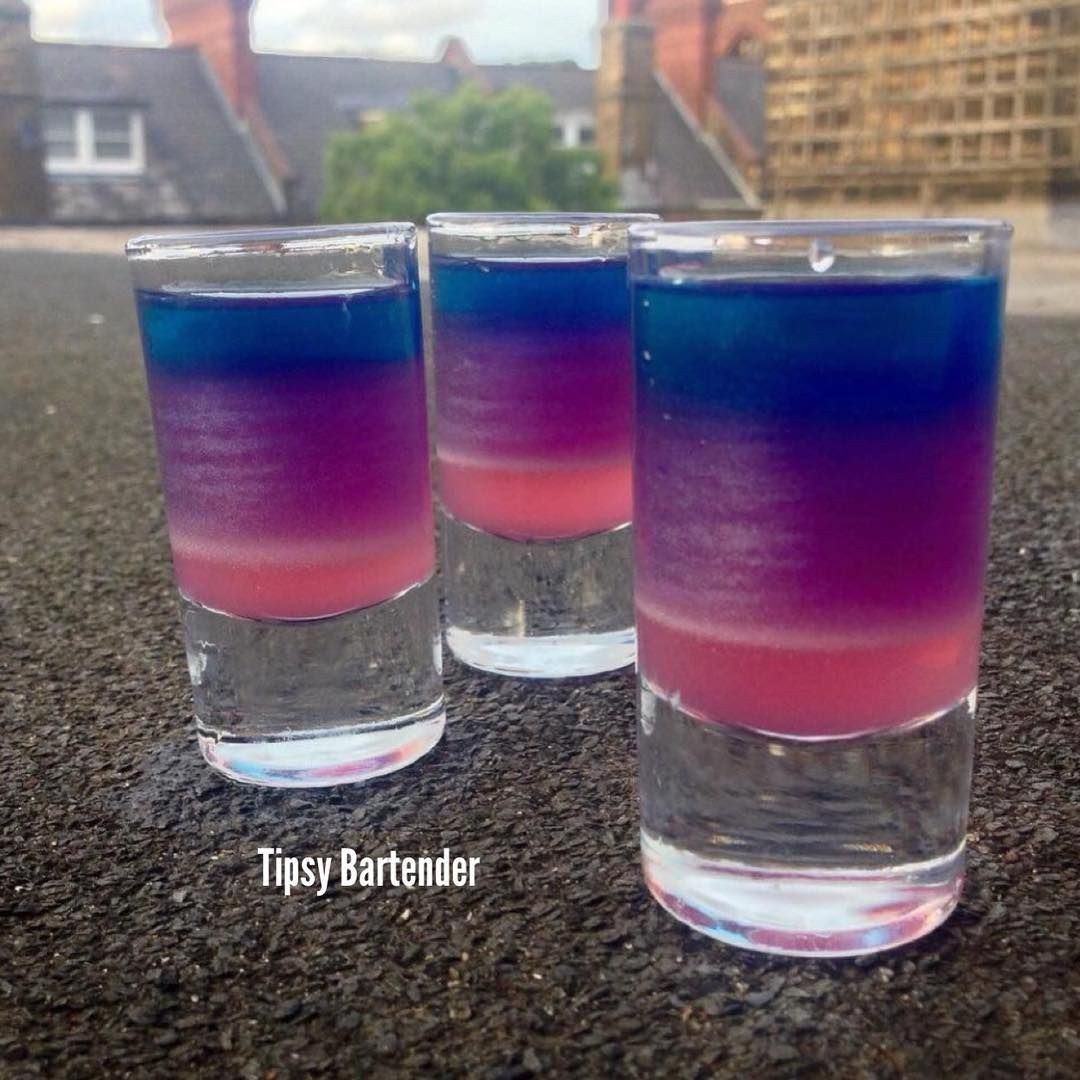 A SHOT OF MAGIC  Pink Layer:  Bubble Gum Syrup  Purple Layer:  Viniq  Blue Layer : Salted Caramel Vodka Blue Curacao