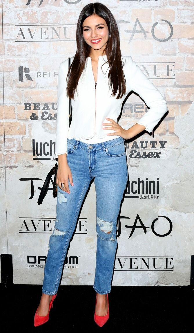 Victoria Justice in a white jacket, ripped jeans and heels