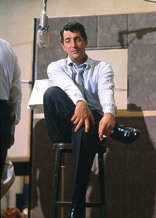 Dean Martin during one of three studio sessions for his album Sleep Warm, with orchestra conducted by Frank Sinatra, 1958