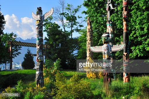 West coast native totem poles in Totem Park, Stanley Park, Vancouver, British Columbia, Canada