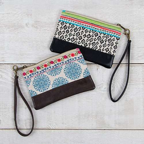 Gypset Wristlet - Globally inspired prints on cotton canvas trimmed in brown and black vegan leather. Adorned with fun tassels and antiqued brass hardware!