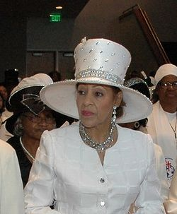 Evangelist Louise Patterson in a tall white sequinned hat