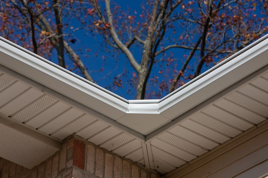 An Up Close Corner Angle Shot Of A Colonial With Siding Displaying Leafguard Gutters By Englert How To Install Gutters Colonial House Gutters