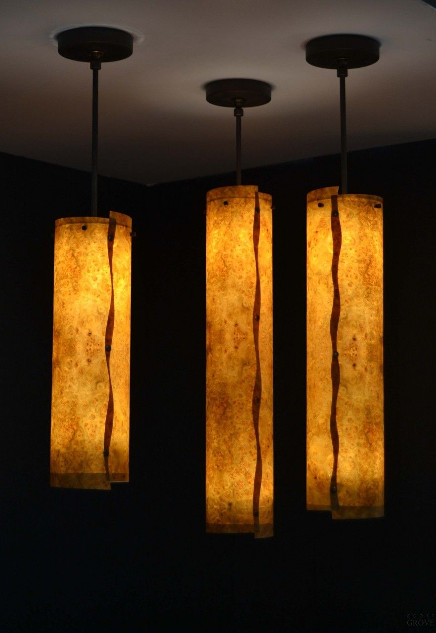 """LED wood veneer pendants"" is one of many pieces in Scott Grove's exquisite collection of art, sculpture, and furniture."