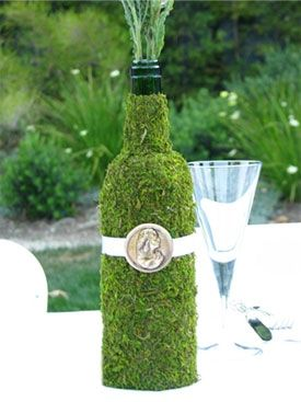 Moss Covered Wine bottle as vase or centerpiece