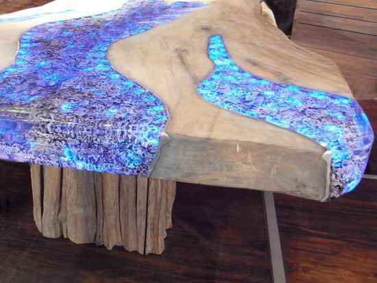 resin inlay in the wood of this old coffee table top. makes this