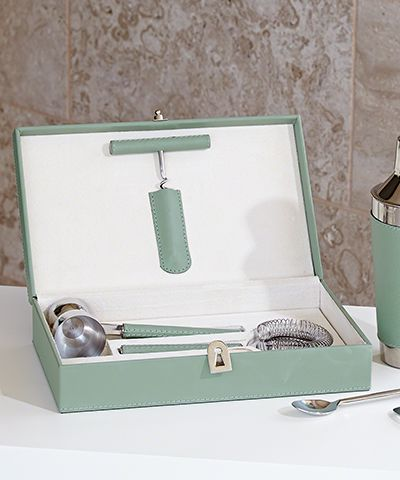 Boxed Bar Tool Set - Leather Celadon - Whether you prefer your libations shaken or stirred, the Cocktail Shaker - Leather Wrapped - Celadon is certain to quench your thirst for the cool of mid-century modern. Glistening stainless steel and smooth-to-the-touch leather lend each piece a sublime sophistication that can't help but call to mind the breezy bonhomie of mid-century social affairs.