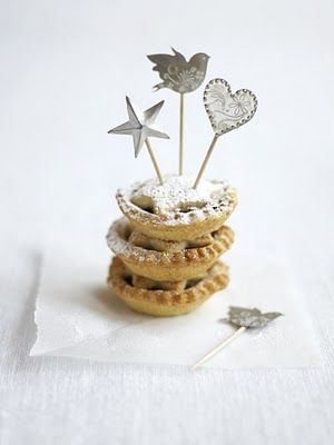 Mince pies with decorated cocktail sticks