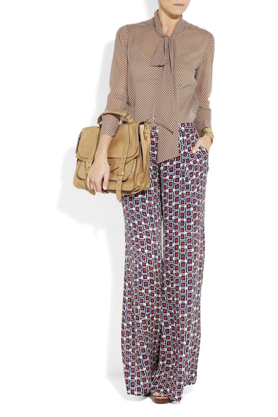EQUIPMENT  Meredith polka-dot silk-chiffon blouse with Proenza Schouler bag.