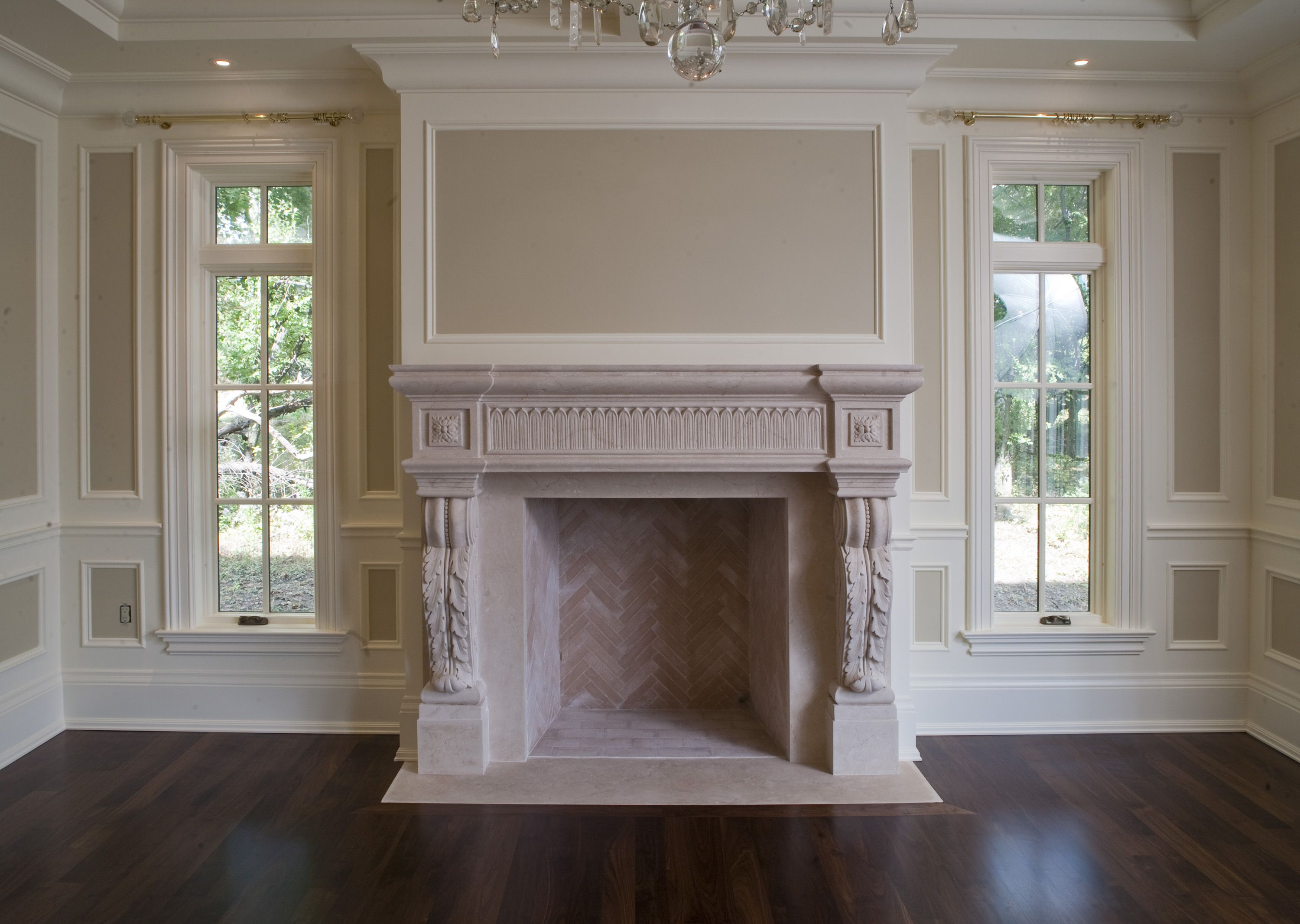 Cast stone fireplace mantel. Very pretty architectural features in ...