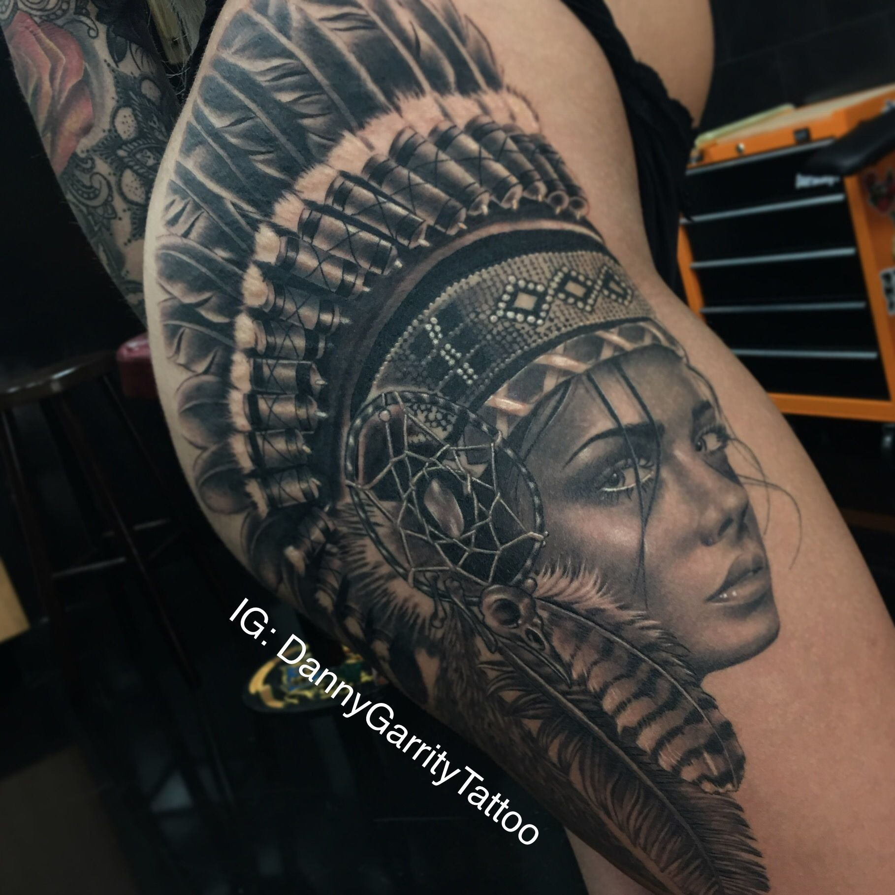 f38ca5a3b Black and grey realistic native girl thigh piece tattoo with Indian  headdress and feathers